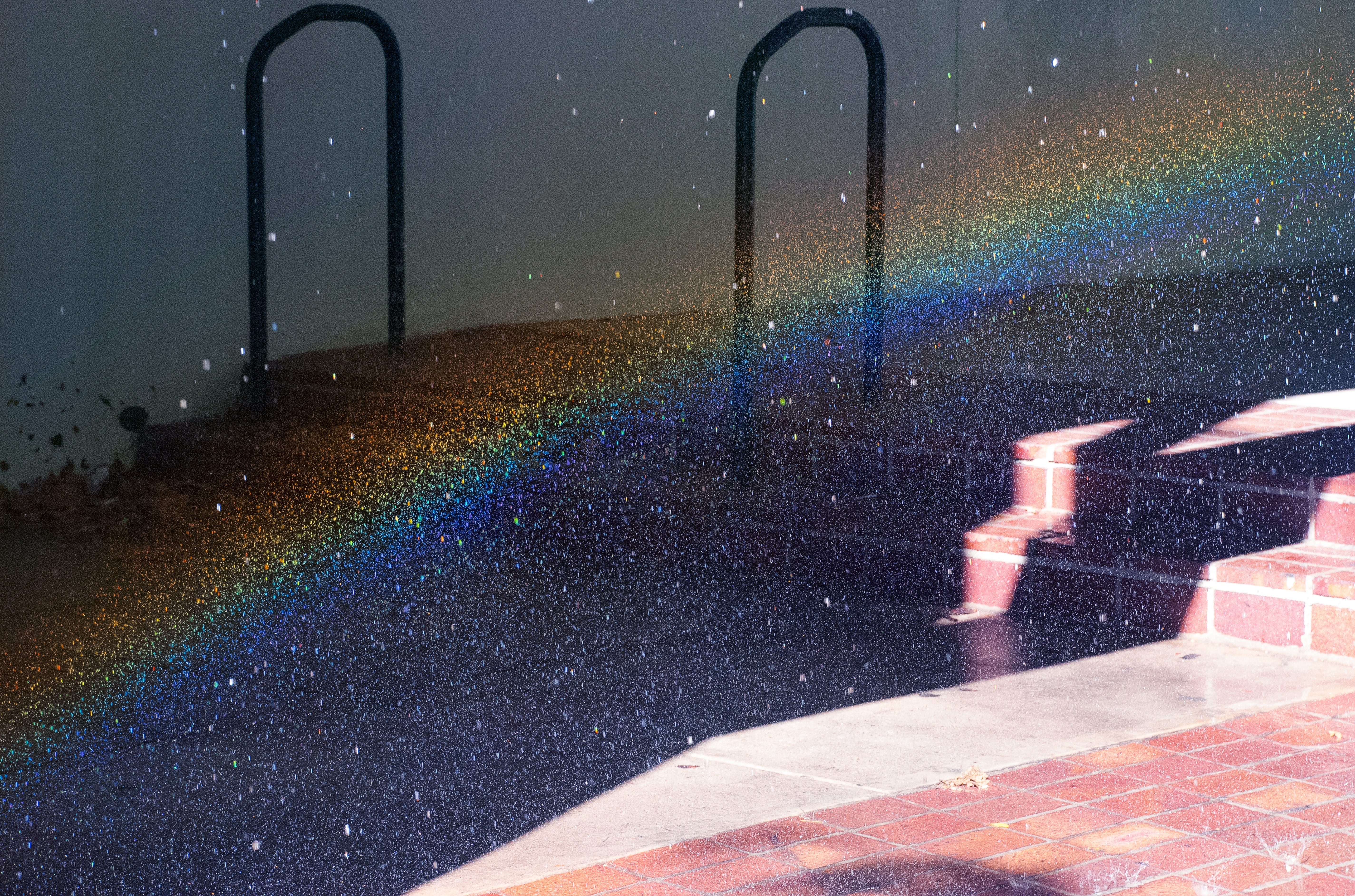 Brick staircase covered with rainbow light particles.