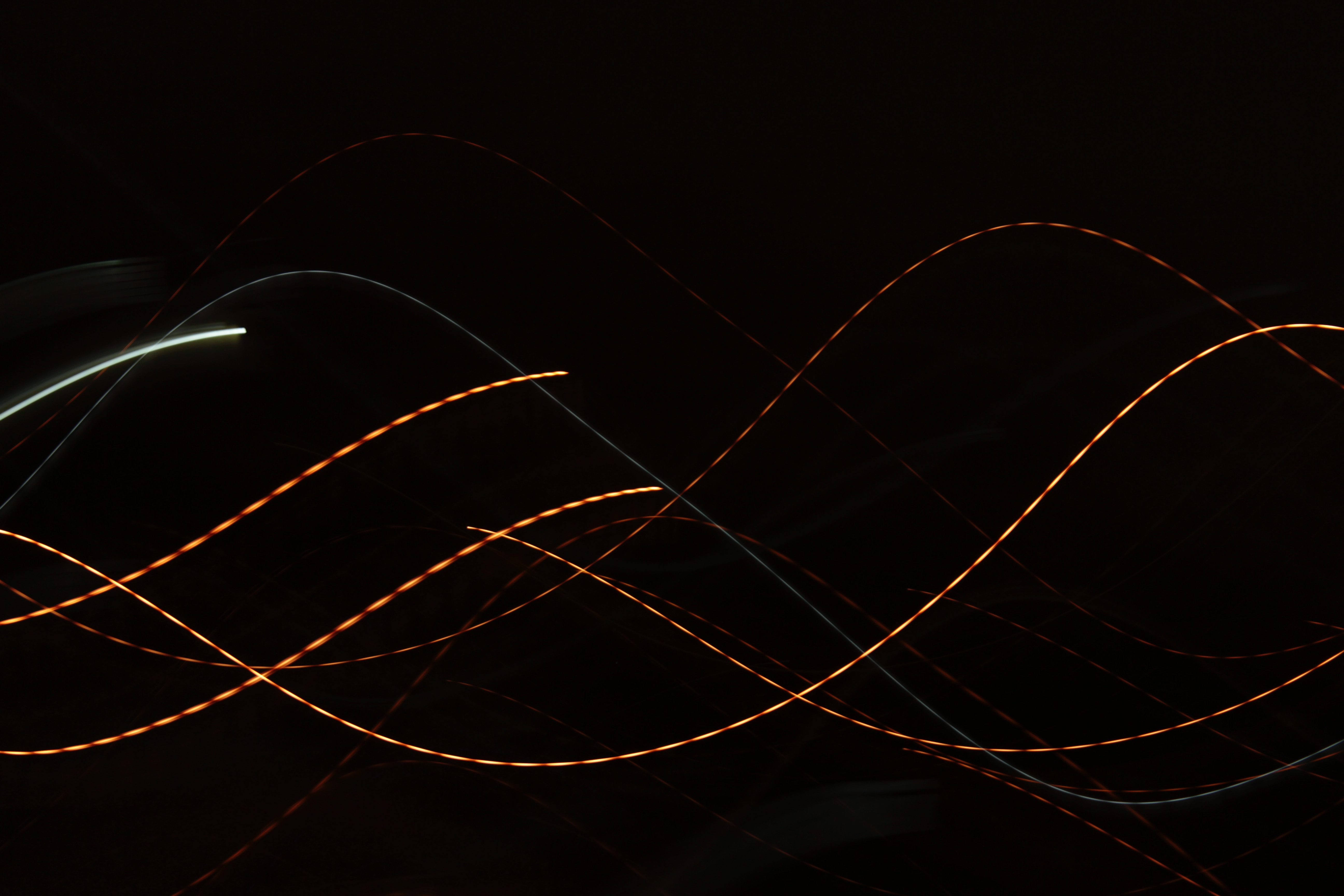 Colorful sine waves on a black background.